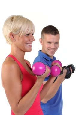 Attractive woman with her personal fitness trainner