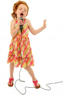 Adorable Child Singing into Microphone