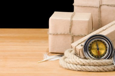 Parcel wrapped box and rope isolated on black