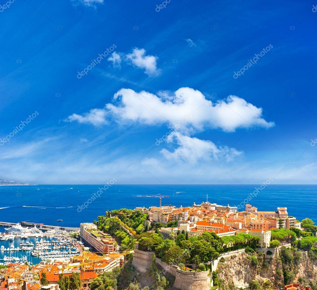 Panoramic view of Monaco with palace and harbor