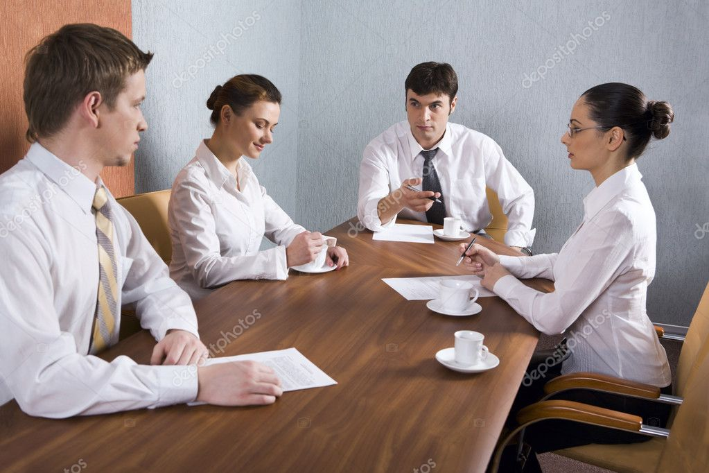 Group of young businessmen are discussing very important question