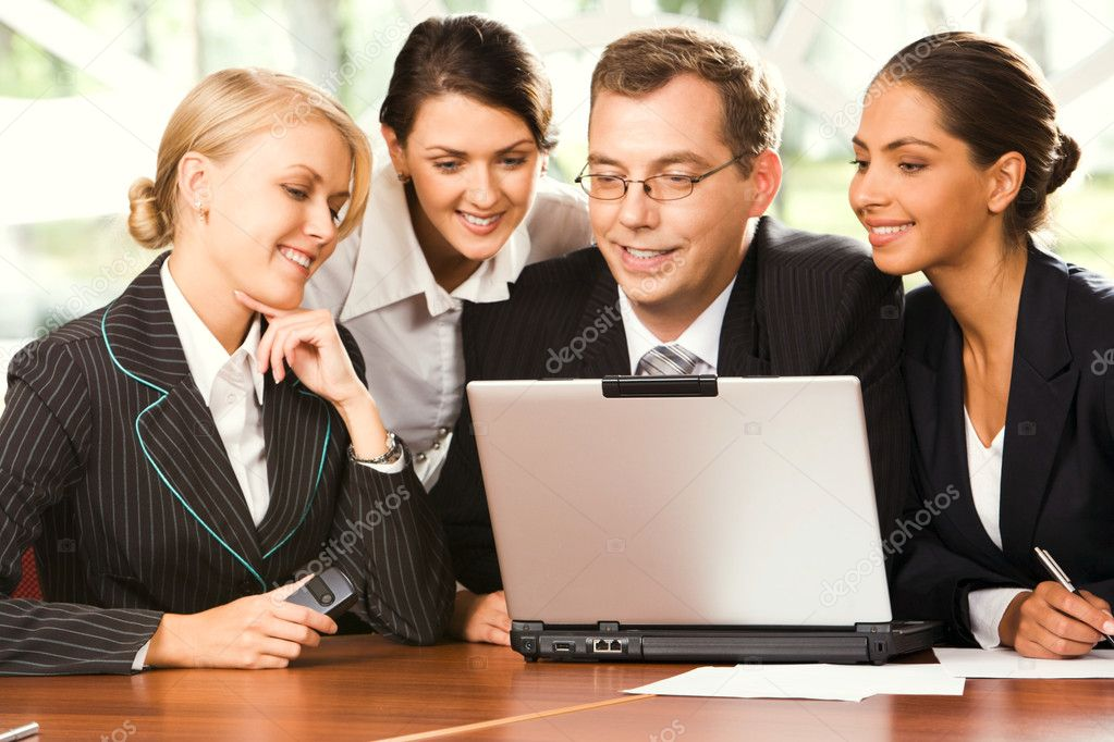 Group of businesspeople working on the laptop