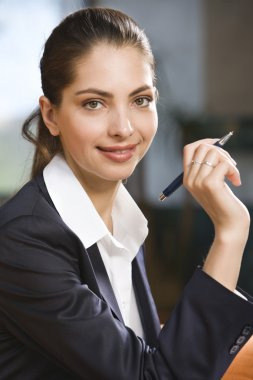 Portrait of smiling business women holding the pen