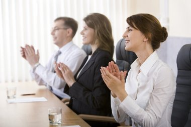 Image of successful business clapping in the office