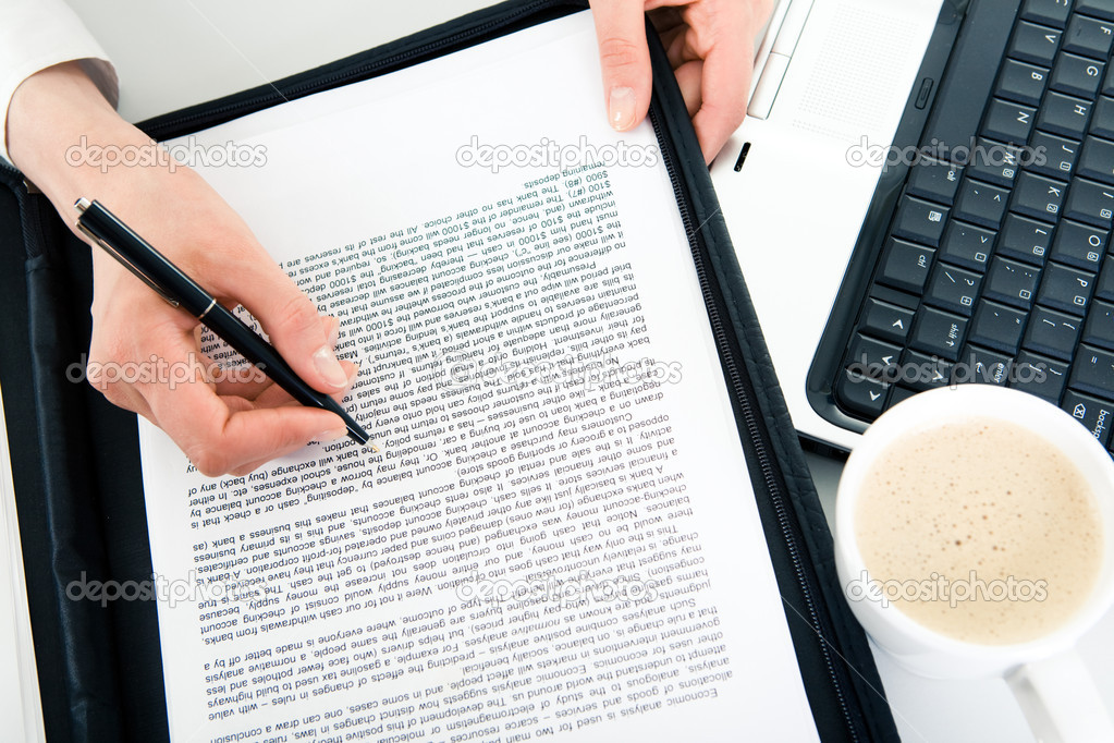 Business contract with female hands holding pen