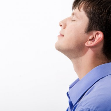Close-up of man's profile keeping his eyes closed in enjoyment stock vector