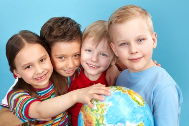 Cute kids with globe