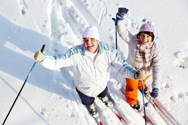 Cheerful skiers