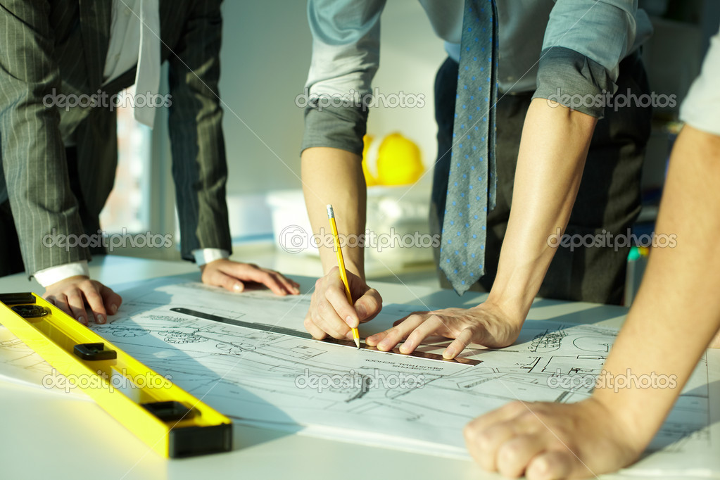 Three pairs of hands sketching a housing project stock vector