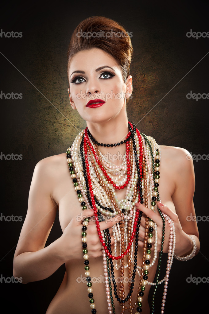 Young beautiful woman with beads and jewelry