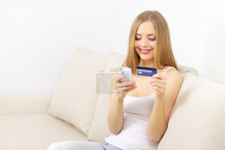 Girl with mobile phone and credit card