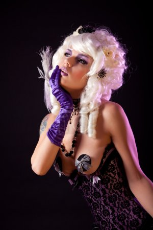 Sensual woman in fashionable corset and white Victorian wig