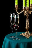 Two glasses of wine and a candlestick