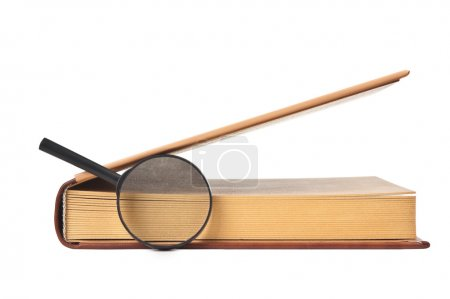 Book and magnifying glass isolated