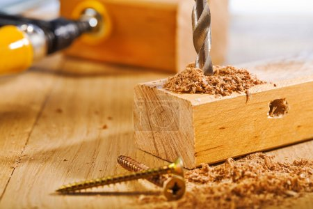 Drilling of wooden board