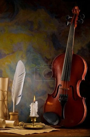 Composition of violin and antique items