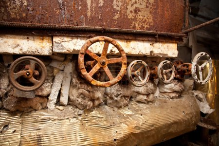 The old rusty metal valves