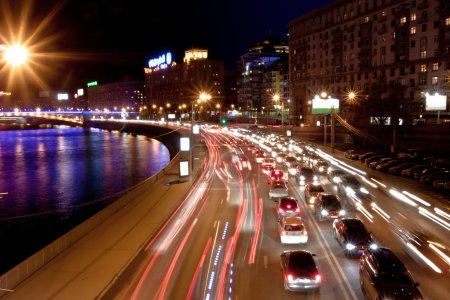 Photo for The image of night traffic jam on city embankment in Moscow - Royalty Free Image