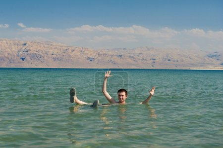 Man floating in the waters of the Dead Sea