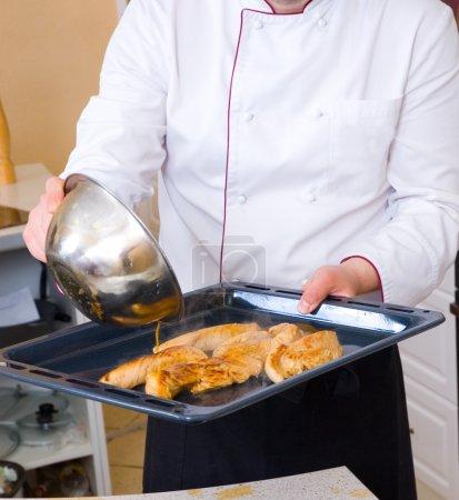 Chef frying chicken fillet