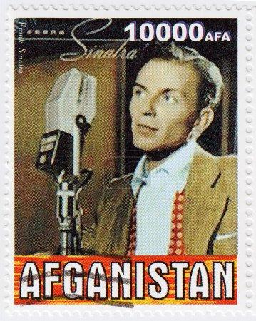 Photo pour Timbre imprimé en Afganistan montre Frank Sinatra dans les années 1960 célèbre chanteur pop musical et acteur américain, vers 1986 - image libre de droit