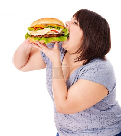 Photo for Overweight woman eating hamburger. Isolated. - Royalty Free Image