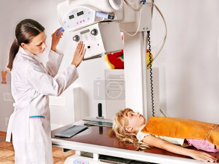 Child with doctor radiologist.
