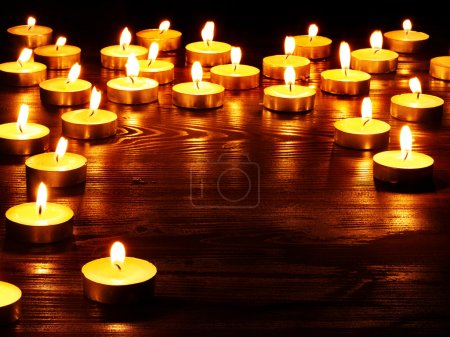 Photo for Group of burning candles on black background. - Royalty Free Image