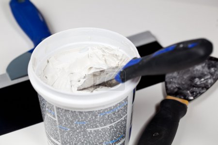 Spackling knive in plaster