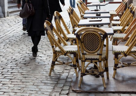 Empty cafe tables in Brussels cobbled square