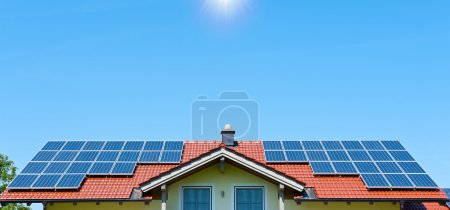 Photo for Farmhouse with Solar Panels on the Roof - Royalty Free Image