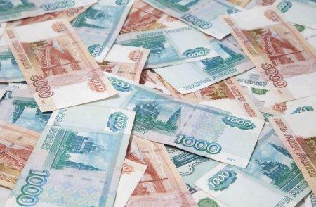 Photo pour Contexte d'un et cinq mille billets de roubles russes - image libre de droit