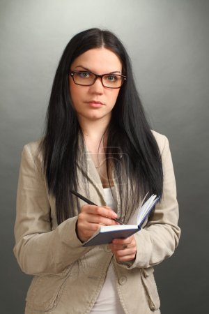The serious girl, the brunette wearing spectacles ...
