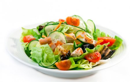 Photo for Closeup of a healthy chicken salad with greens, tomatos and cucumber - Royalty Free Image