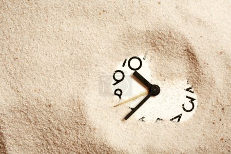 Photo for Time concept. Sand background with clock face - Royalty Free Image