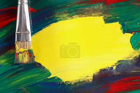 Photo for Painting concept. Abstract painting background with paintbrush and big yellow spot for text - Royalty Free Image