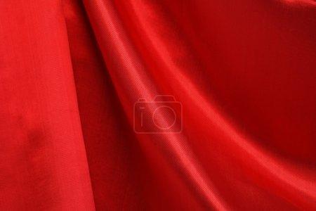 Photo pour Gros plan de rideau de soie rouge. Beau fond - image libre de droit