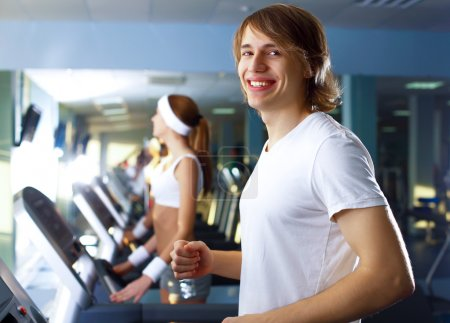 Young man doing sport in gym