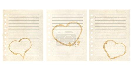 Foto de Corazones de café cae en páginas de cuaderno. aislado en blanco - Imagen libre de derechos