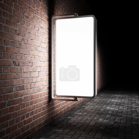 Photo for Blank street advertising billboard on brick wall at night - Royalty Free Image