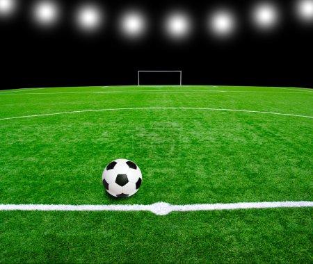 Photo pour Ballon de foot sur le stade - image libre de droit