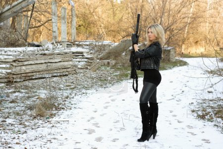 Nice young blonde with a gun