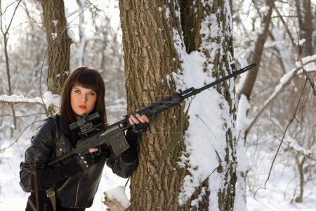 Pretty woman with a sniper rifle