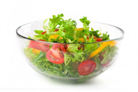 Photo for Fresh green salad with tomatoes and paprika in glass bowl on white background - Royalty Free Image