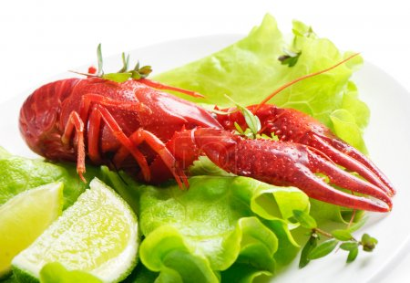 Boiled crawfish with lime and fresh salad