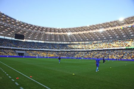 Players run during training session at NSC Olimpiyskiy stadium