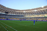 Players run during training session at NSC Olimpiyskiy stadium