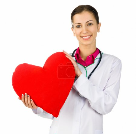 Photo for Doctor taking care of red heart symbol on white background - Royalty Free Image