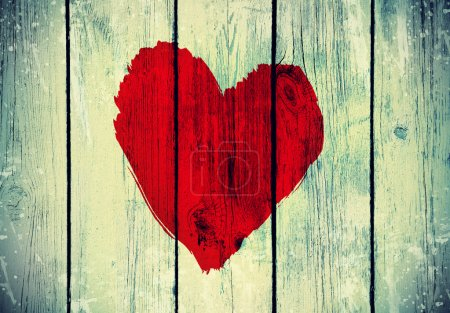 Photo for Drawing love symbol on old wooden wall - Royalty Free Image