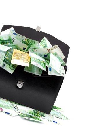 Photo pour Porte-documents noir avec de l'argent sur fond blanc - image libre de droit